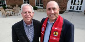 James Oris with Miami chief Douglas Lankford in March 2018. Lankford wears a stole incorporating Myaamia ribbon work designs created by Karen Baldwin.