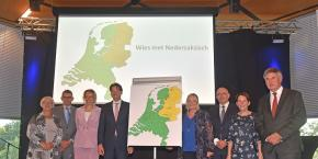 Covenant signing event. On the map of the Netherlands, the area where Low Saxon is spoken is highlighted in yellow.