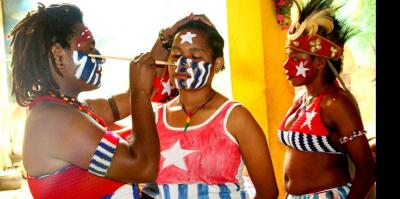 West Papuan women paint their faces with the Morning Star flag before a freedom rally in Jayapura, 19 December 2016
