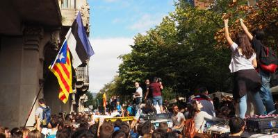 People protest arrest of Catalan government top officials. On left side, a protester holds an Estonian flag